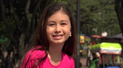 Excited Young Girl at Park During Summer Stock Footage