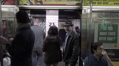 Passengers boarding subway train at 23rd street station doors open close 4K NYC Stock Footage
