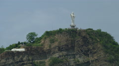 Christ of the Mercy statue on top of hill Stock Footage