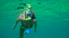 Mor SnorkYoung Happy Woman Snorkeling Underwater In Blue Tropical Water Stock Footage