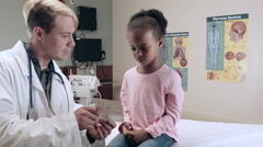 Doctor Doing Exam On Children In Medical Hospital - stock footage