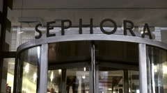 Sephora cosmetics store main entrance sign above revolving door tight shot NY 4K Stock Footage
