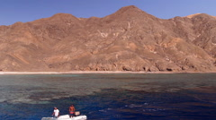 Tropical sandy island in the sea, mountains, rocks, stones Stock Footage