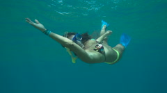 Young Happy Woman Snorkeling Underwater With Peace Sign - stock footage