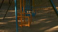 Ungraded: Empty Children's Swing Swinging in Yard Stock Footage