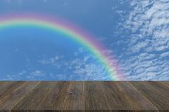 Wood terrace and Blue sky with rainbow Kuvituskuvat