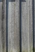 Gray wooden textured siding background - stock photo