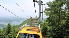 Cable Car Ride in China mountain and lake area Stock Footage