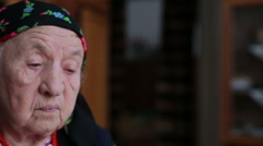 A view of an old woman in a headscarf - stock footage