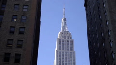 Empire State Building tight shot tilting down New Yorkers in coats cold day 1080 Stock Footage