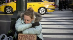 homeless woman in coat on cold winter day on busy street slow motion NYC 1080 HD - stock footage