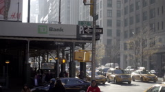 TD Bank on scaffolding zooming out slowly on Park Avenue with taxis driving NYC - stock footage