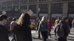New Yorkers crossing street, people walking across the crosswalk on Park Ave NYC Stock Footage