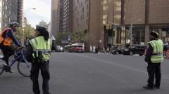 Traffic cops directing cars taxi cab and truck in Midtown Manhattan street NYC Stock Footage