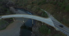 A Tour of Four Jeeps Goes over the Horshoe Bridge at the American River Stock Footage