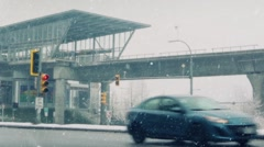 Cars Pass As Trucks Turn Off Highway In Snow Storm Stock Footage