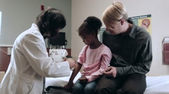 Doctor Doing Exam On Children In Medical Hospital Stock Footage