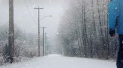 Man Walks On Road In The Snow Stock Footage