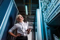 Engineer businesswoman in network server room Kuvituskuvat