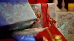 Christmas presents under the Christmas tree - stock footage