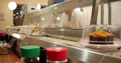 Woman Taking Sushi on Conveyor Belt in Japan Restaurant 4K Stock Video Stock Footage