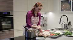 Woman in the kitchen preparing stuffed cabbage Stock Footage