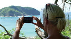 European woman takes pictures with her Samsumg S6 Stock Footage