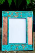 Vintage photo frame on wooden table background with empty white canvas Stock Photos