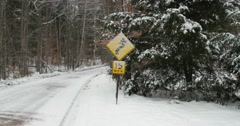 Snow Covered Road Sign on Country Road Stock Video - stock footage