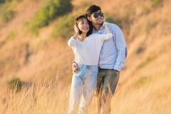 Portrait of asian younger man and woman relaxing vacation at sea side happine Stock Photos