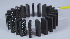 Slow motion domino effect, dominoes falling in circle Stock Footage