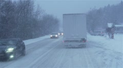 heavy snow on the road with cars in slow motion - stock footage