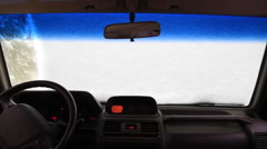 Man Clears Snow on Car Windshield Stock Video - stock footage