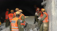 Israeli Homeland Security Soldiers move rubble and debris  Stock Footage