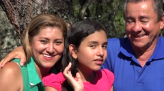 Family Posing at Tree in Public Park Stock Footage
