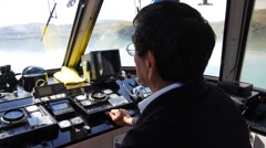 Captain of a pleasure boat in the deckhouse. Grey Lake, Patagonia Stock Footage