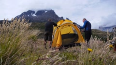 People are mounting the tent in Patagonia - stock footage