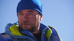 Hiker in blue clothes on the blue sky background (Close up, editorial) - stock footage