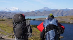 Two hikers on the rout in Patagonia (Chile, editorial) - stock footage