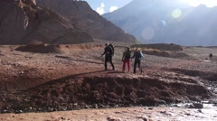 Hikers are crossing the water stream in Patagonia (editorial) Stock Footage