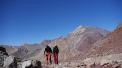 Two hikers on the rout to Aconcagua. Argentina (editorial) Stock Footage