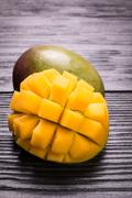 Fresh rip mango on a wooden background.Healthy food - stock photo