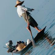 Fisherman at Inle Lake working on one foot Stock Photos