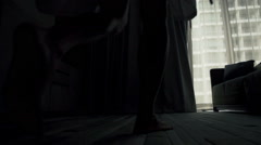 Man in bathrobe unveil curtains, super slow motion 120fps Stock Footage
