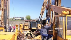 Mobile crane on truck is loading spare part. - stock footage