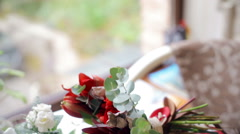 Beautiful wedding bouquet on a table in a cafe Stock Footage