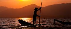 Silhouette of fisherman at sunset Inle Lake Stock Photos