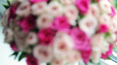 Beautiful pearls and wedding bouquet on window-sill Stock Footage