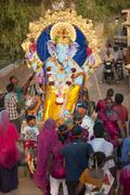 JAISALMER, INDIA - SEPTEMBER 9th: Devotees carying the statue of Lord Ganesha - stock photo