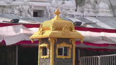 MS of a golden booth in Tirupati, India Stock Footage